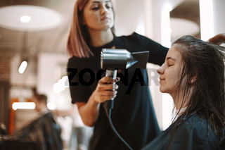 Women discussing beauty products in salon