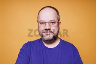 smiling mature man wearing glasses