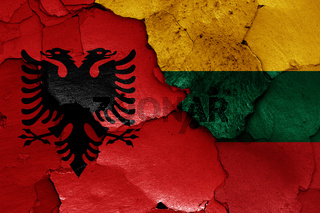 flags of Albania and Lithuania painted on cracked wall