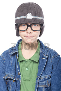 nerd looking teenage boy with glasses and cap, looking funny, isolated on white