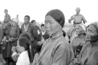 Young Mongolian woman watches the competitions at Naadam festival in the Gobi region, photo 1977