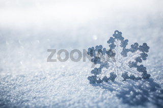 Silver Christmas decoration on snow
