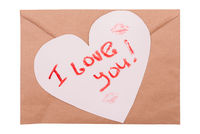Kraft envelope with a white heart, a kiss and the text I love you written in lipstick. Concept valentines day concept. Top view, copy space.