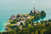 View of the Worthersee lake with Maria Worth church, Carinthia, Austria