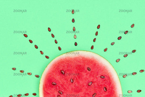 Ripe watermelon with seeds in the form of the sun