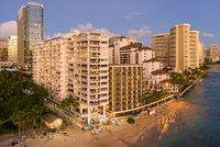 Aerial view of Waikiki beach amd hotels at sunset