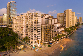 Aerial view of Waikiki beach amd hotels at sunset