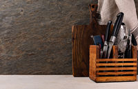 Cutting board and cutlery on wooden kitchen table