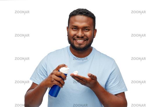 happy african american man with shaving cream