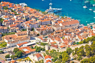 Old town of Hvar bay and harbor aerial view