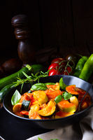zucchini vegetarian ratatouille with tomato sauce and herbs