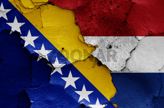 flags of Bosnia and Herzegovina and Netherlands painted on cracked wall