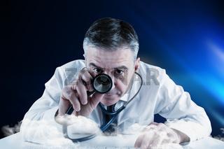 Composite image of mature businessman running diagnostics