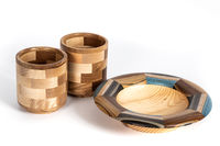 Decorative wooden mugs and a plate on an isolated background.