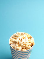 Fresh popcorn on a blue background