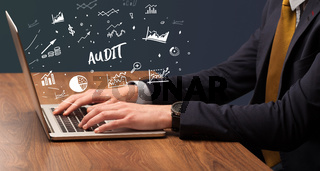 Businessman working on laptop, business concept