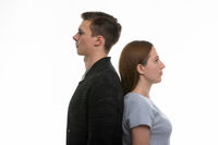 Portrait of a man and a woman standing with their backs to each other