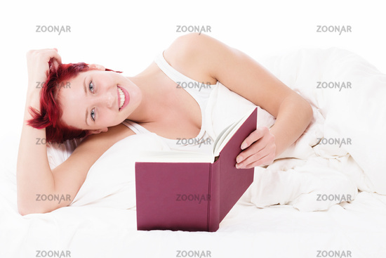 happy in bed reading a book