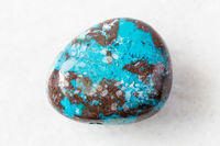 polished Chrysocolla with Cuprite rock on white