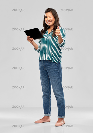 happy asian woman with tablet pc showing thumbs up