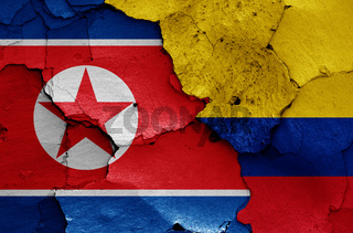 flags of North Korea and Colombia painted on cracked wall