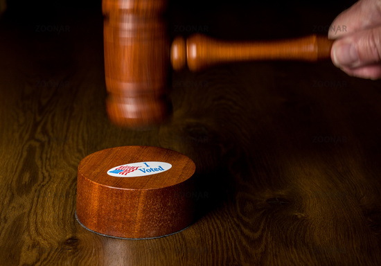 I voted campaign button or sticker with a gavel and mallet to illustrate lawsuits about voting