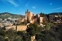 Aerial beautiful drone point of view Granada castle surrounding lands and cityscape, Alhambra or Red Castle, located on top of hill al-Sabika. Moorish palace fortress complex in Andalusia, Spain