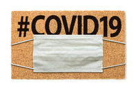 Welcome Mat With Medical Face Mask and #COVID19 Text Isolated on White Amidst The Coronavirus Pandemic