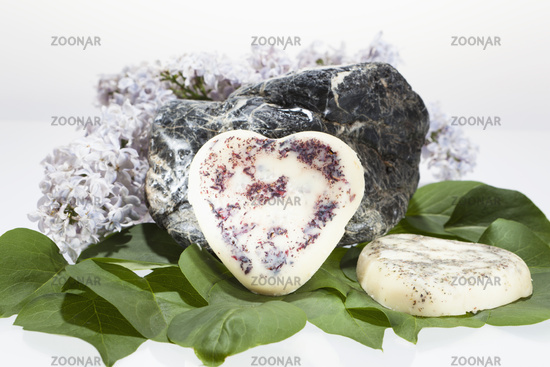 Body Butter in front of a stone