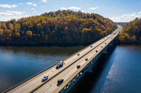 Traffic on the interstate through fall colors on Cheat Lake Morgantown, WV with I68 bridge