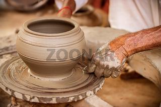 Potter at work makes ceramic dishes. India, Rajasthan.