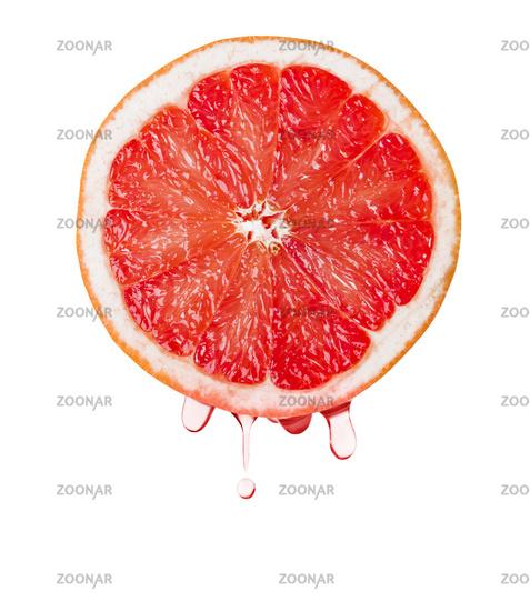 Ripe grapefruit and drops of juice