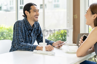 Asian couple eating out at new normal restaurant