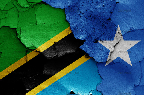 flags of Tanzania and Somalia painted on cracked wall