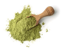 Wooden scoop of henna powder