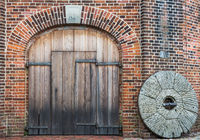 Wooden Door and old millstone, Jever Windmill, Friesland, Lower Saxony, Germany