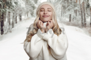 Woman enjoying her winter knitted sweater