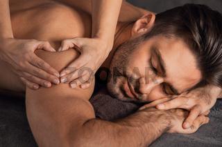 Man love back massage at spa