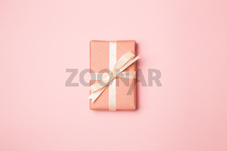 Pink gift box isolated on pink background