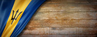 Barbados flag on vintage wood wall banner
