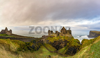 Ruins of Dunluce Castle on the edge of cliff. Filming location of popular TV show.