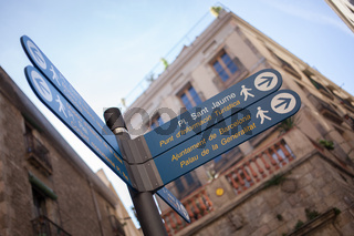 Sign post with directions in the center of Barcelona