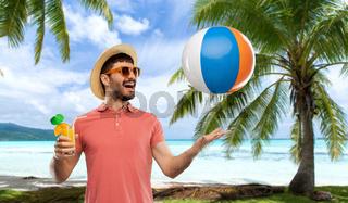 happy man with orange juice and beach ball