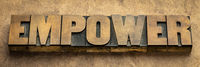 empower word in vintage wood type