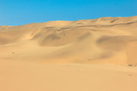 Big sand dunes panorama. Desert and coastal beach sand landscape scenery. Abstract background.