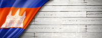 Cambodian flag on old white wall banner