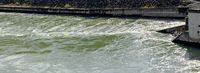 water swirl at the outpouring of a hydroelectric turbine
