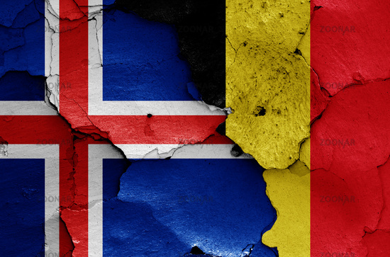 flags of Iceland and Belgium painted on cracked wall
