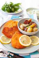 Schnitzel and baked potatoes