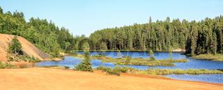 Idyllic Blue lake and forest landscape in evening sunset sunlight. Foy, Foyross Lake, Sudbury, Ontario, Canada.